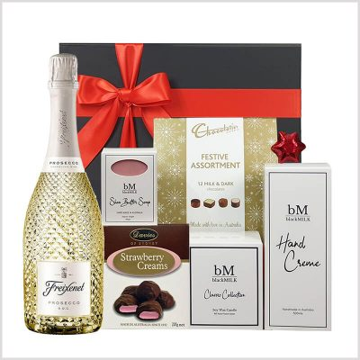 Christmas Glamour gift hamper with beauty products and candle